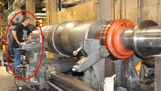 Dangerous Heavy Duty Lathe Machine Process Big Shaft. Heavy Metal Machining to Aerospace Component