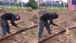 Man vs train tracks: Rail worker cutting through train tracks is about to experience pain – TomoNews